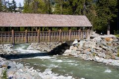 Wooden bridge. Across a river in Whistler, British Columbia stock images