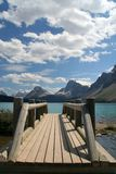Wooden bridge. To a mountain lake Stock Photo