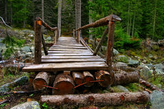 A wooden bridge. Wooden brigdge over a river in pirin planina through deep forest Royalty Free Stock Photos