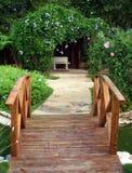 Wooden Bridge. A wooden bridge over a pond in a garden Stock Photography