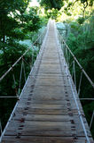 Wooden Bridge. Suspension bridge leading to the bright side Stock Photos