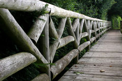 Wooden bridge. Wooden footbridge made from logs in country park Royalty Free Stock Image