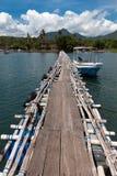 Wooden bridge above indian ocean. In bali island Royalty Free Stock Images