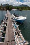 Wooden bridge above indian ocean. In bali island Stock Photography