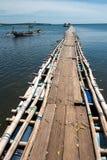 Wooden bridge above indian ocean. In bali island Royalty Free Stock Photos