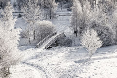 Wooden bridge from above. Snowy, wooden bridge in a winter day. View from above Stock Photo