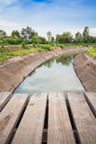 Wooden bridge across the canal Stock Image