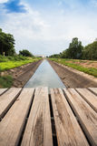 Wooden bridge across the canal Royalty Free Stock Photo