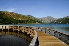 Wooden bridge across the lake Royalty Free Stock Image
