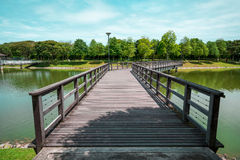 Wooden bridge across the lake at S2 City Park, Seremban 2, Malaysia Royalty Free Stock Image