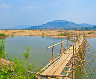 Wooden bridge across Mekong river Royalty Free Stock Photos