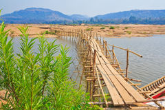 Wooden bridge across Mekong river Royalty Free Stock Images