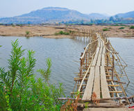 Wooden bridge across Mekong river Royalty Free Stock Image