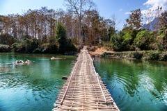 Old wooden bridge across mountain river. Laos, Vang Vieng. Wooden bridge across mountain river. Laos, Vang Vieng Royalty Free Stock Image