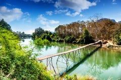 Old wooden bridge across mountain river. Laos, Vang Vieng. Wooden bridge across mountain river. Laos, Vang Vieng Stock Images