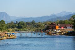 Wooden bridge across Nam Song river at Vang Vieng. Laos Stock Photography