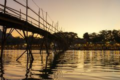 Wooden bridge across Nam Song river at Vang Vieng. Laos stock photos