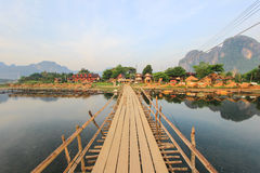 Wooden bridge across Nam Song River in Vang Vieng,Laos Royalty Free Stock Images