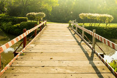 Wooden bridge across the pond Royalty Free Stock Images