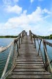 Wooden bridge across reservoir Royalty Free Stock Image