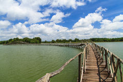 Wooden bridge across reservoir Royalty Free Stock Photo