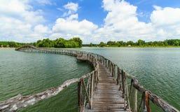 Wooden bridge across reservoir Stock Photo