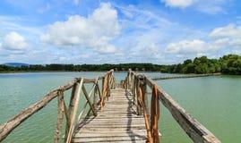 Wooden bridge across reservoir Stock Images