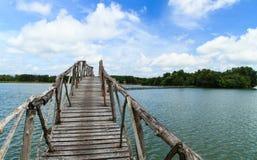 Wooden bridge across reservoir Royalty Free Stock Photography
