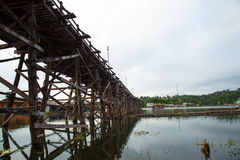 Wooden bridge across the river. Royalty Free Stock Photo