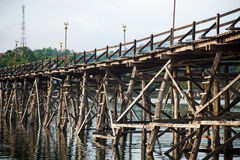 Wooden bridge across the river. Stock Image
