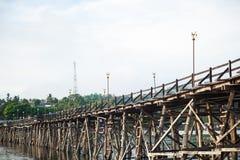 Wooden bridge across the river. Stock Images