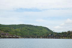 Wooden bridge across the river. Royalty Free Stock Photography