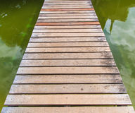 Wooden bridge. Across the river as the way to the success Royalty Free Stock Photography