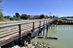 Wooden bridge across a river bay Royalty Free Stock Photo