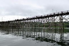Wooden bridge across river stock image