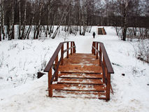 Wooden bridge across the river and a wooden staircase Stock Photos