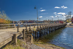 Wooden bridge across the Strait Royalty Free Stock Image