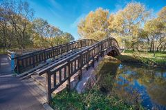 Wooden bridge across Yauza river royalty free stock image