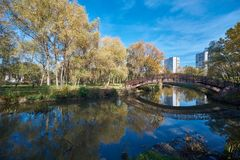 Wooden bridge across Yauza river stock images