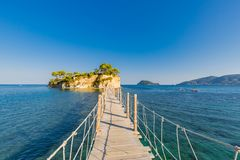 Wooden bridge from Agios Sostis leading to small rocky island. Bay of Laganas, Zakynthos island, Greece stock photos