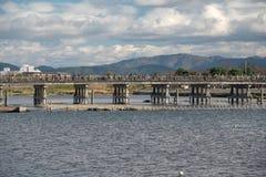 Wooden bridge in Arashiyama, Japan. Arashiyama is a popular tour Stock Photography