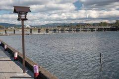 Wooden bridge in Arashiyama, Japan. Arashiyama is a popular tour Royalty Free Stock Images