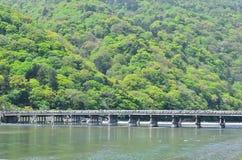 Wooden bridge at Arashiyama, Kyoto Japan. Natural scene of Togetsu bridge at Arashiyama district in Kyoto Japan on spring Stock Image