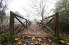 Wooden bridge in autumn. Cloudy Royalty Free Stock Photography