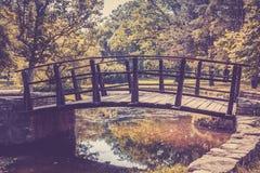 Wooden bridge in autumn landscape stock photo