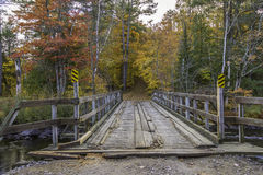 Wooden Bridge in Autumn - Ontario, Canada. Wooden Bridge Leading to a Forest in Autumn - Ontario, Canada royalty free stock images