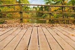 Wooden bridge in the autumn park Stock Photography