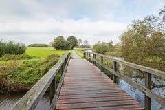 Wooden bridge in an autumnal landscape Stock Photo