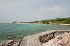 Wooden  bridge  on the beach Stock Photography