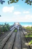 Wooden bridge on beach. Into the sea Stock Photo